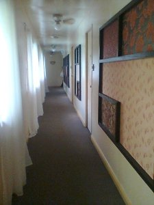 Long hallway heading to the breakfast hall of Hotel Bella vista...