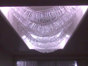 You wouldn't believe, those are plastic spoon and forks created as chandeliers of the lobby!