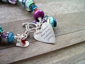 The heart that loves is always young.  http://customlampworkjewelry.com/item_295/The-Heart-that-Loves-is-always-young-Boro-Bracelet.htm