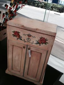 Looked like a vintage/ shabby chic type cabinet to me...