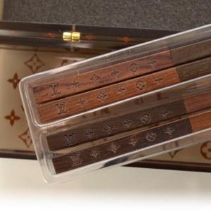 Courtesy of: http://www.fashionphile.com/louis-vuitton-rosewood-monogram-chopsticks-vip-w-case-new-35940